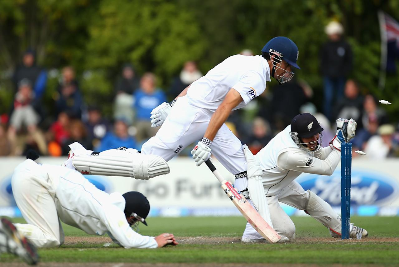 DUNEDIN, NEW ZEALAND - MARCH 09:  BJ Watling of New Zealand attempts to run out Alastair Cook of England during day four of the First Test match between New Zealand and England at University Oval on March 9, 2013 in Dunedin, New Zealand.  (Photo by Phil Walter/Getty Images)