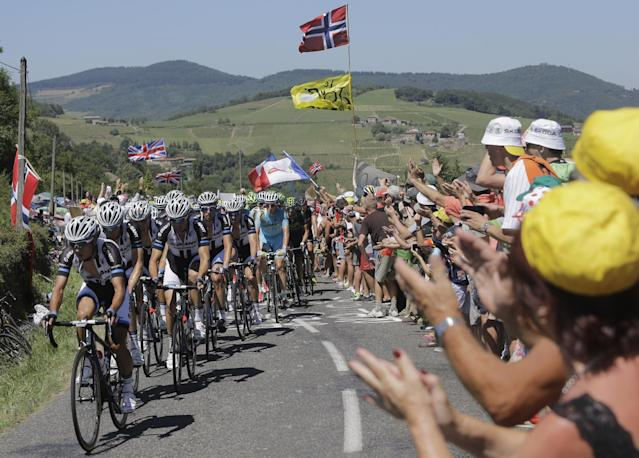 """China's Cheng Ji, front, nicknamed the """"breakaway killer"""" sets the pace of the pack with his Giant Shimano teammates as they chase after a breakaway during the twelfth stage of the Tour de France cycling race over 185.5 kilometers (115.3 miles) with start in Bourg-en-Bresse and finish in Saint-Etienne, France, Thursday, July 17, 2014. Cheng is the first Chinese rider to take part in the Tour de France. (AP Photo/Laurent Cipriani)"""