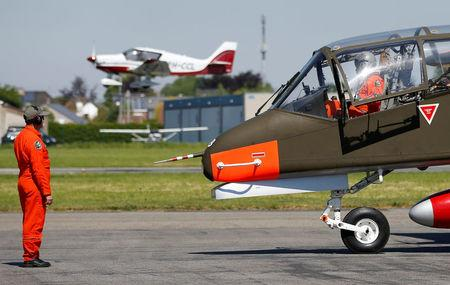 A technician inspects an OV-10 Bronco aircraft before taking off at Flanders international airport in Wevelgem