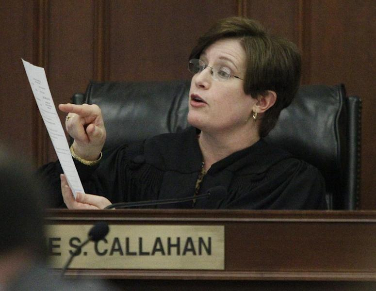 Summit County Judge Lynne S. Callahan instructs the jury on how to fill out different forms after closing statements in the trial of Richard J. Beasley on Monday, March 11, 2013 in Akron, Ohio. The murder case against Beasley, the alleged triggerman charged with killing three men by luring them with Craigslist job offers went to the jury on Monday after the prosecution asked jurors to use common sense and return a guilty verdict. (AP Photo/Akron Beacon Journal, Paul Tople, Pool)