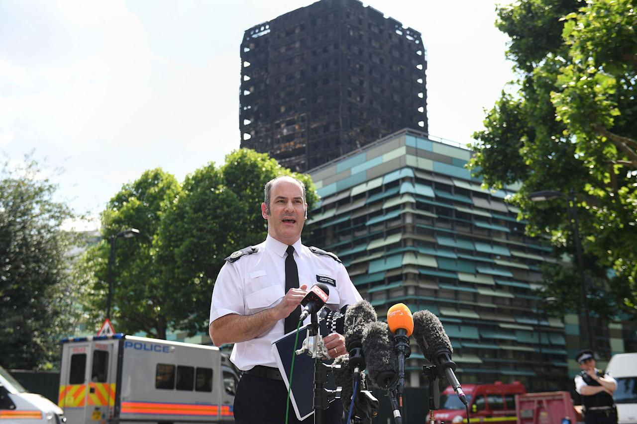 <p>Metropolitan Police Commander Stuart Cundy speaks to the media near Grenfell Tower after a fire engulfed the 24-storey building, in London, Saturday June 17, 2017. London police say 58 people who were in Grenfell Tower are still missing and assumed to be dead. Cundy said Saturday that this number, which was based on reports from the public, may rise. He says it will take weeks or longer to recover and identify all the dead in the public housing block that was devastated by a fire early Wednesday. (Victoria Jones/PA via AP) </p>
