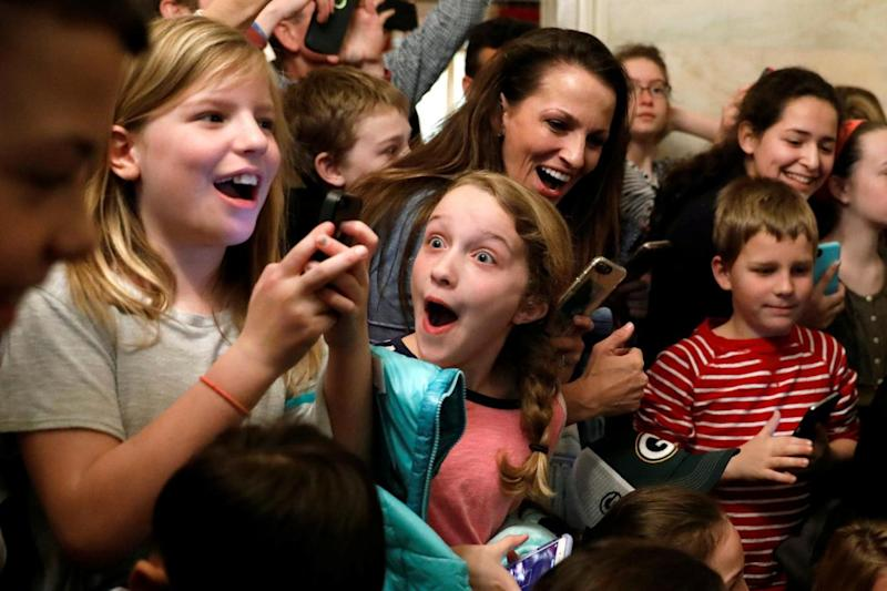 A young girl reacts after Mr Trump makes his surprise appearance (REUTERS)