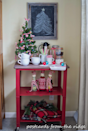 "<p>Deck out your go-to place for a warm cup of your favorite festive beverage with cozy plaid throws and seasonal bottle cozies.</p><p>See more at <a href=""http://www.postcardsfromtheridge.com/2014/12/home-for-holidays-2014-christmas-home.html"" rel=""nofollow noopener"" target=""_blank"" data-ylk=""slk:Postcards From the Ridge"" class=""link rapid-noclick-resp"">Postcards From the Ridge</a>.</p>"