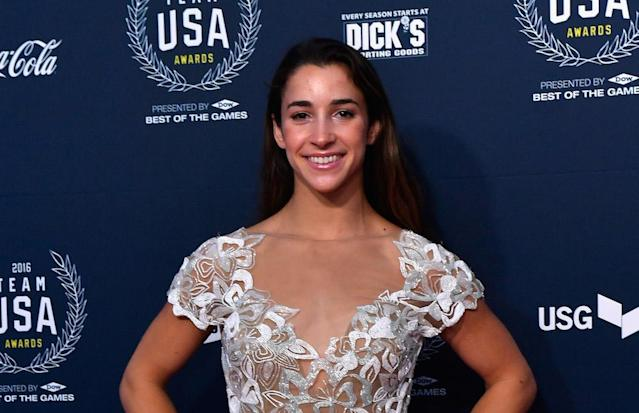 Aly Raisman designed adorable high socks featuring her totally squirmy parents