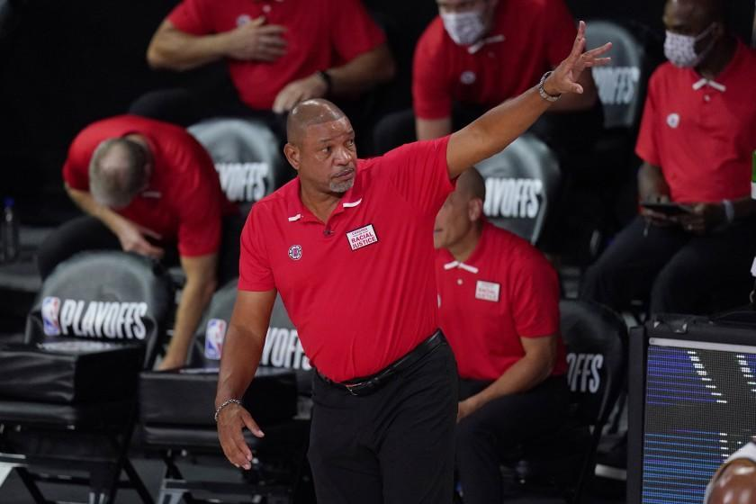 Los Angeles Clippers head coach Doc Rivers waves to the Denver Nuggets after the Clippers defeated the Nuggets in an NBA conference semifinal playoff basketball game Thursday, Sept 3, 2020, in Lake Buena Vista Fla. (AP Photo/Mark J. Terrill)