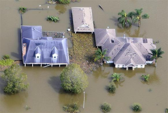 Houses are partially submerged in flood waters after a Hurricane Isaac levee breach in Braithwaite, Louisiana August 31, 2012.