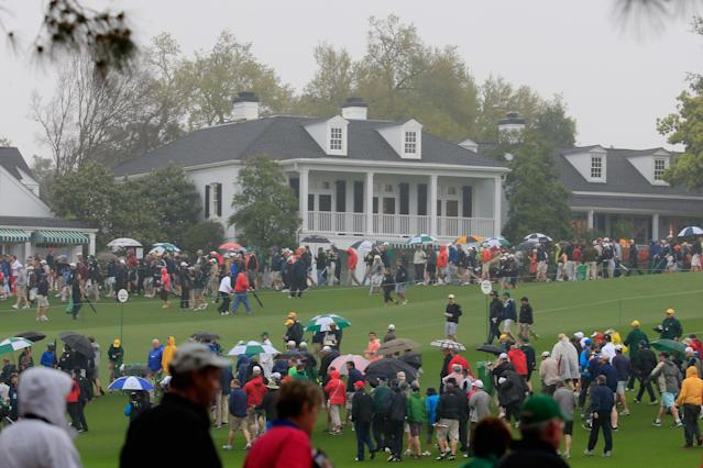 AUGUSTA, GA - APRIL 07: Patrons are evacuated from the course after play was suspended due to weather during a practice round prior to the start of the 2014 Masters Tournament at Augusta National Golf Club on April 7, 2014 in Augusta, Georgia. (Photo by Rob Carr/Getty Images)
