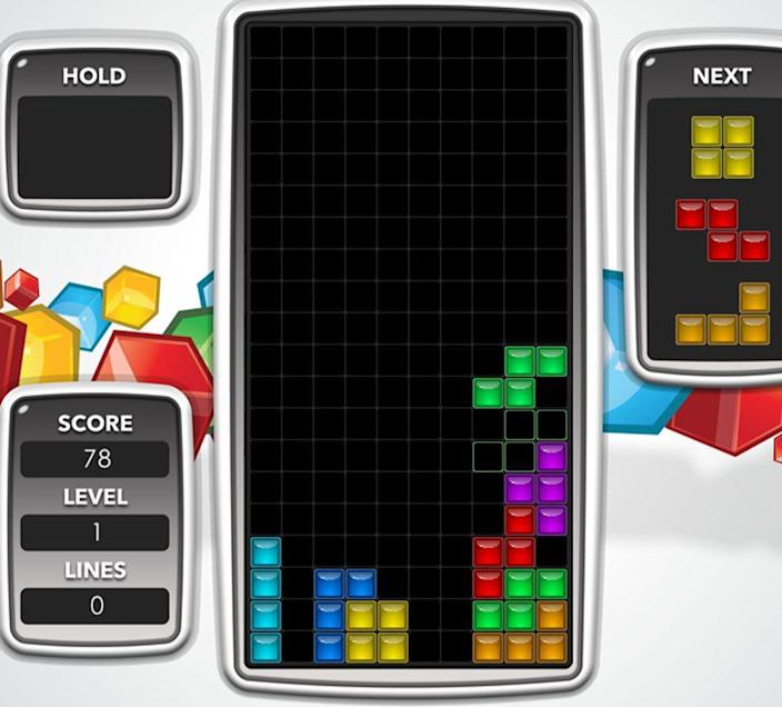 """<p>The popular tile matching game is still popular today, you can play versions for free at <a href=""""https://tetris.com/"""" rel=""""nofollow noopener"""" target=""""_blank"""" data-ylk=""""slk:tetris.com"""" class=""""link rapid-noclick-resp"""">tetris.com</a>. The hours we spent in the 80s trying to figure out the patterns of which tetromino (a shape made out of four square blocks) was coming next could have been better spent seeing the outdoors, or studying calculus. But instead the music still runs through our heads like a catchy earworm at the worst times. </p>"""