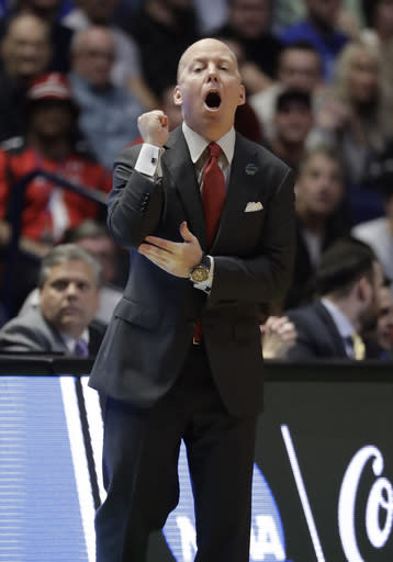 Cincinnati head coach Mick Cronin gestures from the sidelines, during the first half of a second-round game against Nevada in the NCAA college basketball tournament in Nashville, Tenn., Sunday, March 18, 2018. (AP Photo/Mark Humphrey)