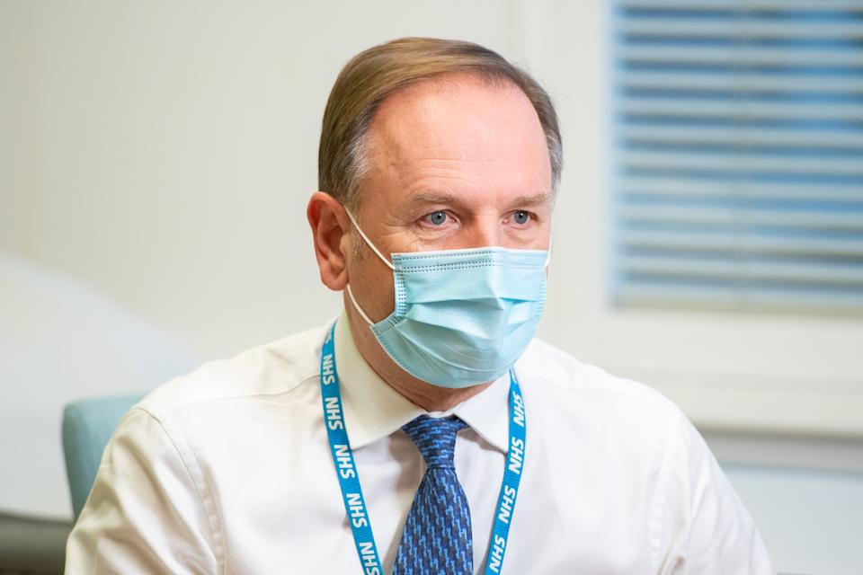 Sir Simon Stevens, the Chief Executive of the National Health Service in England, at the Royal Free Hospital in London to see preparations and meet staff who will be starting the coronavirus vaccination programme from tomorrow.