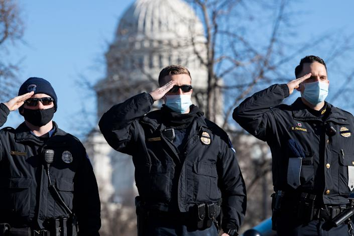 U.S. Capitol Police officers salute as the hearse carrying the body of their colleague, Officer Brian Sicknick, passes by in Washington on Jan. 10. Sicknick, 42, died from injuries suffered in the Jan. 6 attack on the U.S. Capitol that followed a rally headlined by then-President Donald Trump. (Photo: Tom Williams via Getty Images)