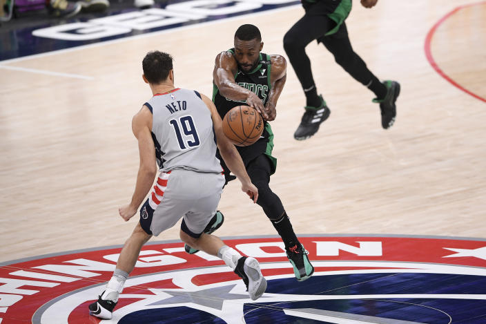Boston Celtics guard Kemba Walker, right, is fouled by Washington Wizards guard Raul Neto (19) during the first half of an NBA basketball game, Sunday, Feb. 14, 2021, in Washington. (AP Photo/Nick Wass)