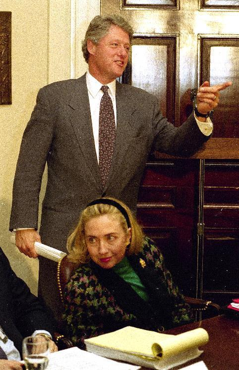 FILE - In this Jan. 25, 1993 file photo, President Bill Clinton, accompanied by first lady Hillary Rodham Clinton, attends a meeting of his health care advisers at the White House in Washington. The president earlier named his wife of head the National Health Care Task Force. This time, it's Bill Clinton's turn to be the adoring spouse, rapt and smiling when the cameras cut away from the candidate in the spotlight. He'll be the He in the VIP box watching as a She accepts the presidential nomination at the Democratic convention on Thursday, July 28, 2016. It's one small step in the role reversal that Americans will need to get used to if Hillary Clinton wins in November. (AP Photo/Greg Gibson, File)