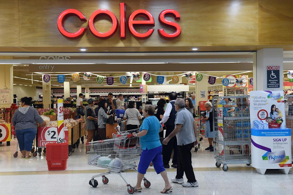 Shoppers queue at the registers at a Coles supermarket in Sydney on Thursday, Oct. 22, 2015. (AAP Image/Paul Miller)