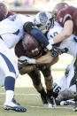 Montana running back Jordan Canada, center,pushes through the defense of San Diego defensive tackle Jalen Smith (94) and safety Joe LaBarbera (10) during the first half of an NCAA college football playoff game, Saturday, Nov. 29, 2014, in Missoula, Mont. (AP Photo/Lido Vizzutti)