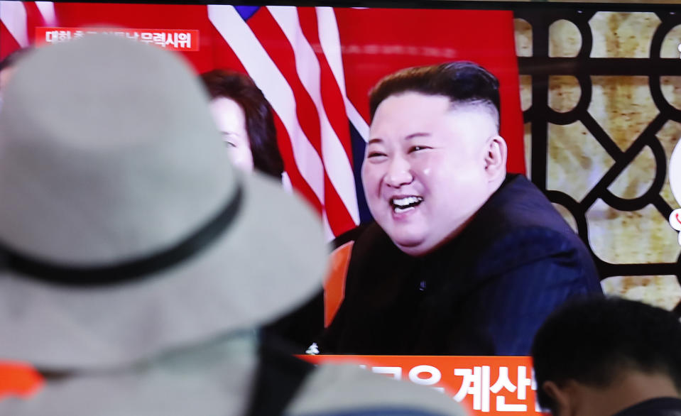 People watch a TV showing a file image of North Korean leader Kim Jong Un during a news program at the Seoul Railway Station in Seoul, South Korea, Tuesday, Sept. 10, 2019. North Korea launched at least two unidentified projectiles toward the sea on Tuesday, South Korea's military said, hours after the North offered to resume nuclear diplomacy with the United States but warned its dealings with Washington may end without new U.S. proposals. (AP Photo/Ahn Young-joon)