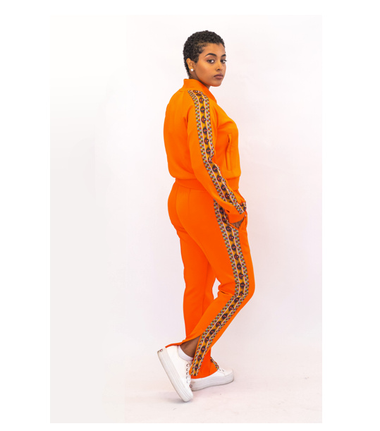 """<p><strong>Yema </strong></p><p>yemacalif.com</p><p><strong>$100.00</strong></p><p><a href=""""https://www.yemacalif.com/women/yema-classic-trackpants-5n3ey"""" rel=""""nofollow noopener"""" target=""""_blank"""" data-ylk=""""slk:Shop Now"""" class=""""link rapid-noclick-resp"""">Shop Now</a></p><p>Yema cofounders Yema Khalif and Hawi Awash donate 20 percent of each sale to support impoverished children in the Kibera slums of Nairobi, Kenya, and orphaned children in Ethiopia. In addition to subsidizing relief efforts abroad, this marigold tracksuit is trimmed with a 17th-century Abyssinian angels print that enriches the ensemble with historical symbolism. </p>"""
