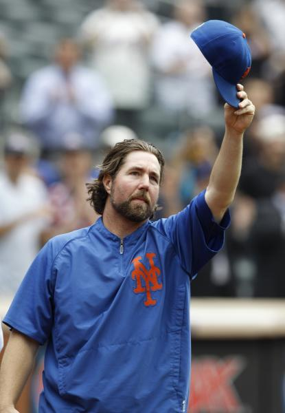 New York Mets starting pitcher R.A. Dickey tips his cap to the crowd as he celebrates his 20th victory of the season after the Mets 6-5 win against the Pittsburgh Pirates in a baseball game at Citi Field in New York, Thursday, Sept. 27, 2012. (AP Photo/Kathy Willens)