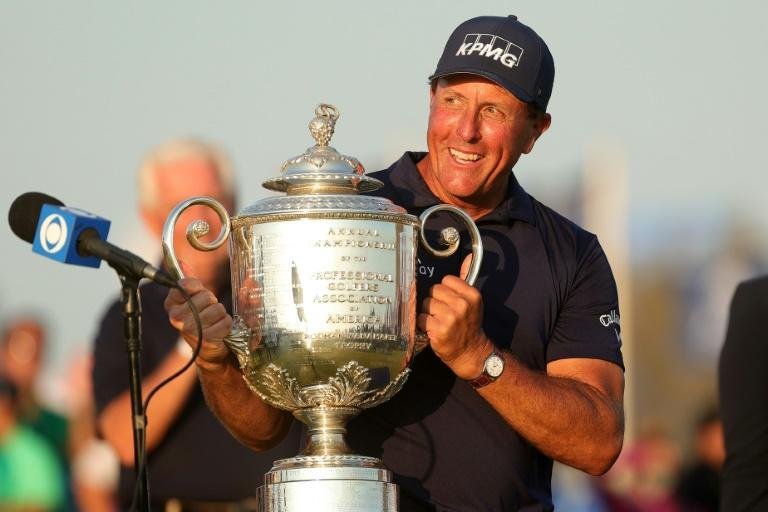 Phil Mickelson celebrates becoming the oldest major winner at the age of 50 with the Wanamaker Trophy after winning the PGA Championship at Kiawah Island