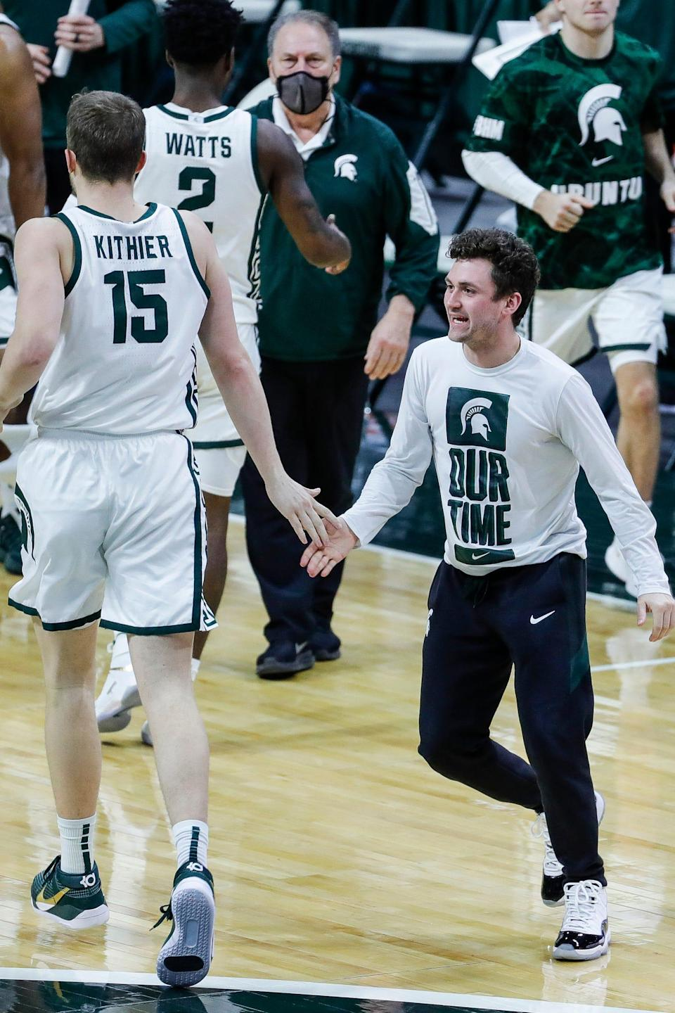Michigan State guard Foster Loyer (3) high fives forward Thomas Kithier (15) during the first half against Illinois at the Breslin Center in East Lansing, Tuesday, Feb. 23, 2021.