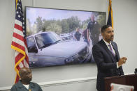 Attorney Justin Bamberg, right, speaks and his client Clarence Gailyard, left, listens, after Bamberg showed body camera video of an officer stomping Gailyard in the neck as Bamberg holds a news conference on Tuesday, Aug. 3, 2021 in Orangeburg, South Carolina. Orangeburg Public Safety officer David Lance Dukes was fired and charged with a felony after the July 26 incident. (AP Photo/Jeffrey Collins)
