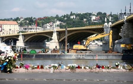 A dredge is seen near a tourist boat accident site in the Danube river in Budapest