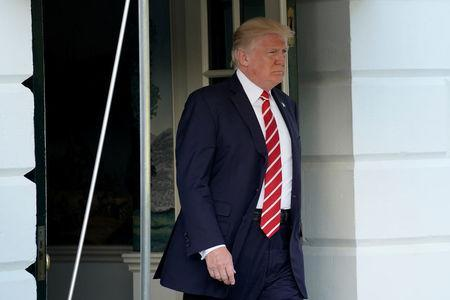 U.S. President Donald Trump walks out from the White House in Washington before his departure to Greensboro, North Carolina, U.S., October 7, 2017. REUTERS/Yuri Gripas