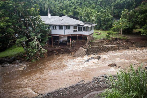 PHOTO: A home on Kahekili Highway near the Waihee River Bridge, was evacuated after a flash flood breached the property, Sept. 12, 2018, in Maui, Hawaii. (Cindy Ellen Russell/Honolulu Star-Advertiser/AP)