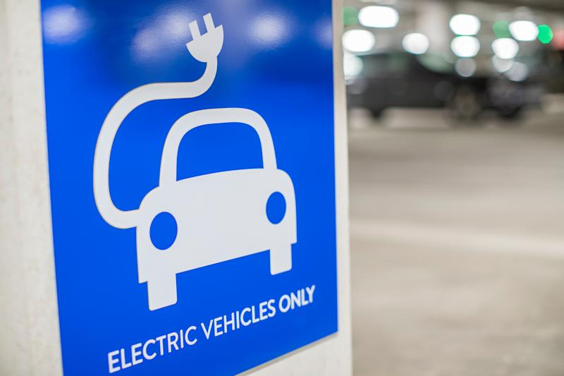A sign that reads electric vehicles only
