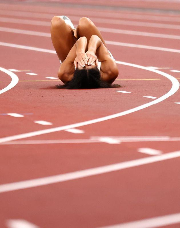 Johnson-Thompson reacts after falling down in the 200m (Photo: Andrew Boyers via Reuters)