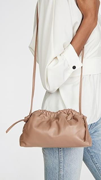<p>Give your structured bags a little downtime and swap in for a soft pillowy option like this <span>Mansur Gavriel Mini Cloud Clutch</span> ($495)</p>