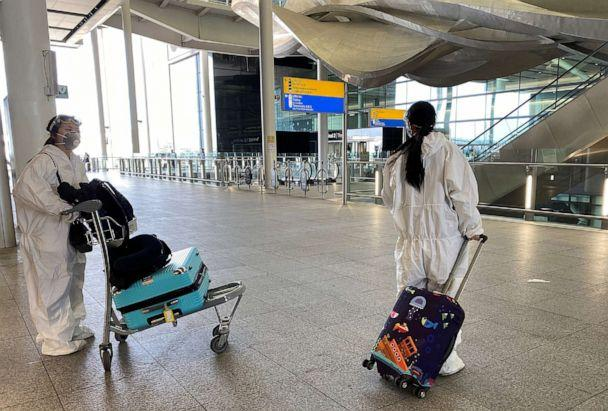 PHOTO: Passengers wearing protective clothing are seen at Heathrow Airport, amid the coronavirus disease (COVID-19) outbreak, in London, May 22, 2020. (Toby Melville/Reuters)