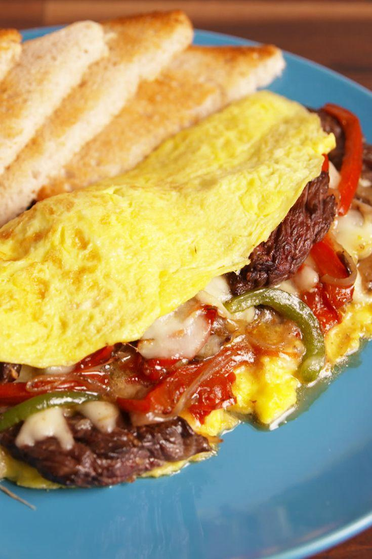 """<p>The hearty breakfast you deserve!</p><p>Get the recipe from <a href=""""/cooking/recipe-ideas/recipes/a52313/philly-cheesesteak-omelet-recipe/"""" data-ylk=""""slk:Delish"""" class=""""link rapid-noclick-resp"""">Delish</a>.</p>"""