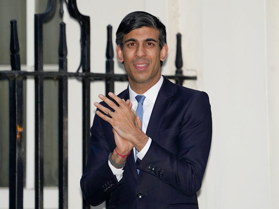 Rishi Sunak joins applause to salute NHS staff in April 2020PA