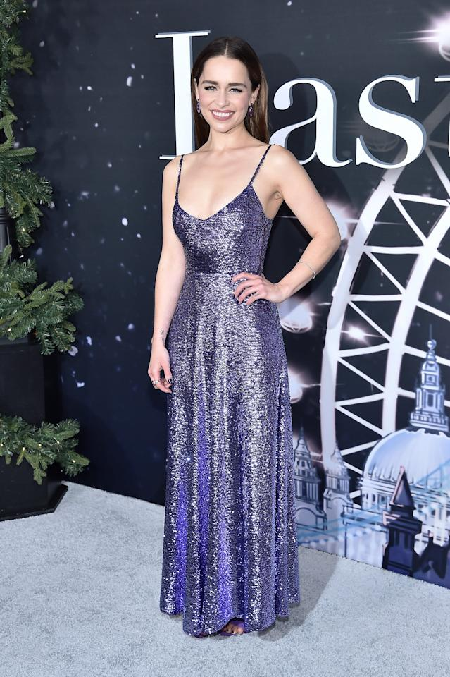 "<p>Wearing a gorgeous <a href=""https://www.popsugar.com/fashion/emilia-clarke-purple-valentino-dress-last-christmas-premiere-46827638"" class=""ga-track"" data-ga-category=""Related"" data-ga-label=""https://www.popsugar.com/fashion/emilia-clarke-purple-valentino-dress-last-christmas-premiere-46827638"" data-ga-action=""In-Line Links"">purple Valentino gown</a> that reminded us of a sparkly Christmas tree ornament. </p>"