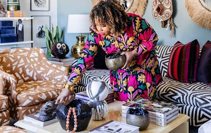 """Ariene Bethea, owner and """"chief huntress"""" with Dressing Rooms Interiors Studio in Charlotte, suggests evoking fall with fur throws and branches in vases."""