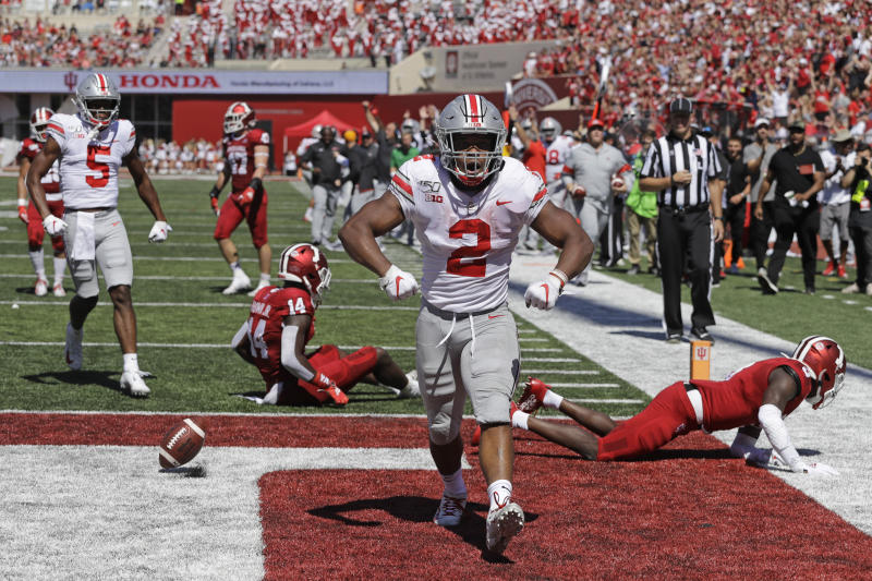 FILE - In this Sept. 14, 2019, file photo, Ohio State running back J.K. Dobbins (2) celebrates after scoring a touchdown during the first half of an NCAA college football game against Indiana, in Bloomington, Ind. Dobbins has rushed for 425 yards and four touchdowns while averaging 7.1 yards per carry. No. 6 Ohio State knows the games are going to get harder eventually, but so far everything has just seemed, well, so easy. (AP Photo/Darron Cummings, File)