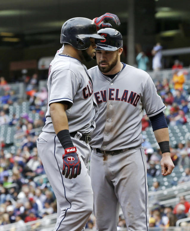 Cleveland Indians' Carlos Santana, left, and Jason Kipnis celebrate after Santana's two-run home run off Minnesota Twins pitcher Cole DeVries in the fourth inning of a baseball game, Saturday, Sept. 28, 2013, in Minneapolis. (AP Photo/Jim Mone)