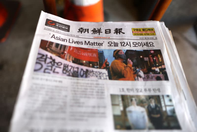 A Los Angeles Koreatown newspaper is seen at a protest to denounce hate against the Asian American and Pacific Islander communities, following the deadly shootings at Young's Asian Massage in Georgia, in Koreatown in Los Angeles