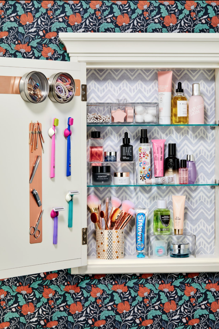 """<p>Shelf risers give you double the space for storage. Keep short jars underneath and taller sprays and bottles up top so you can easily spritz and go. </p><p><strong>RELATED:</strong> <a href=""""https://www.goodhousekeeping.com/home/organizing/tips/g424/master-bathroom-organizing/"""" rel=""""nofollow noopener"""" target=""""_blank"""" data-ylk=""""slk:Clever Bathroom Organizing Ideas"""" class=""""link rapid-noclick-resp"""">Clever Bathroom Organizing Ideas </a></p>"""