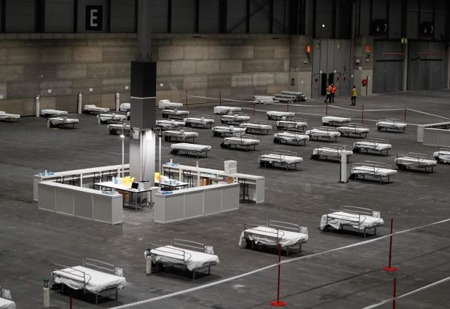 Health workers prepare to receive the first patients at IFEMA exhibition complex on Sunday. (Getty)