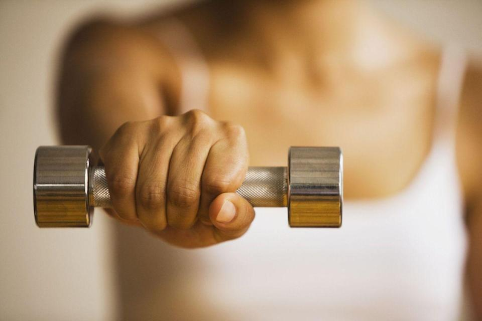 <p>Looking for a few moves to add to a beginner arm workout? Bollig loves this particular exercise for newbies and gives options for making it harder as you get stronger.</p><p><strong>How to: </strong>Stand tall with feet hip-width apart and hold a dumbbell in each hand in front of your hips with your palms facing down. Raise both arms directly in front of you until your hands are parallel to your shoulders. Hold at the top for a 2 second count, then lower back down slowly. To make things more challenging, hold the dumbbells at the top for a slow 10 second count down.<br></p>
