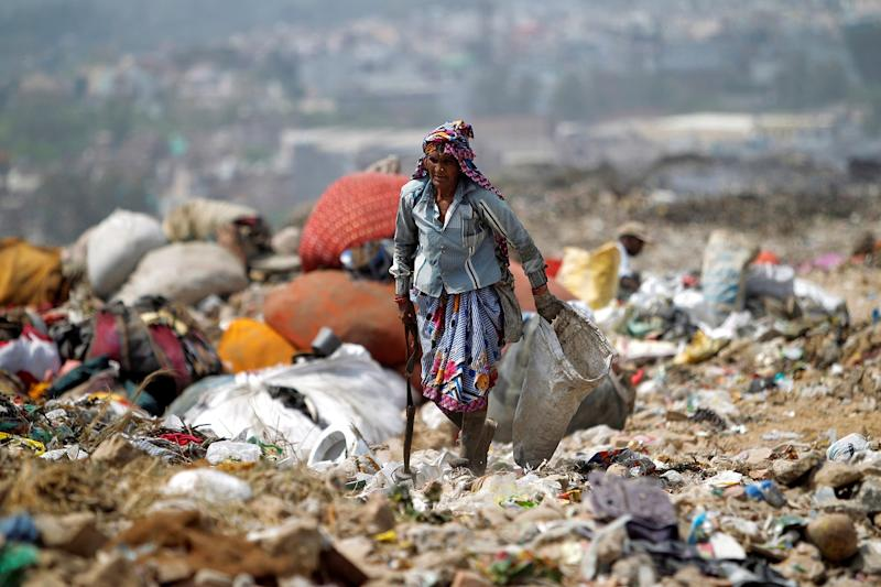 Since most waste pickers come from the economically backward classes and Dalit community, they are usually shunned from mainstream society and have limited interactions with people outside their own community. (Photo by REUTERS/Anindito Mukherjee)