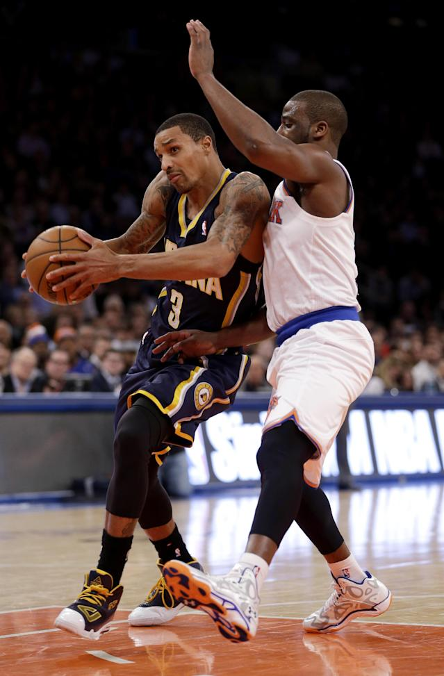 New York Knicks's Raymond Felton, right, defends Indiana Pacers' George Hill during the first half of an NBA basketball game at Madison Square Garden, Wednesday, March 19, 2014, in New York. (AP Photo/Seth Wenig)