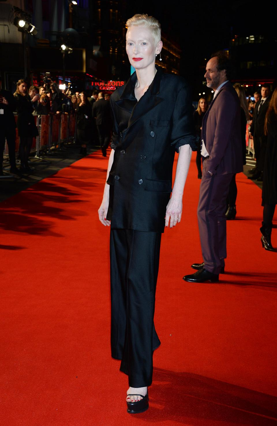 <p>Famous for not using a stylist, Tilda looked as effortlessly chic as ever in a double breasted jacket and trousers. <em>[Photo: Getty]</em> </p>