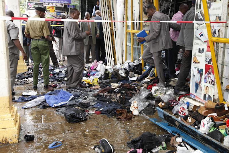 The scene of the explosion  on a busy road in downtown Nairobi, Kenya, Monday, May 28, 2012. An apparent explosion ripped through a building, full of small shops in downtown Nairobi on Monday, wounding an unknown number of people. The force of the blast ripped apart the one-story building's aluminum roof, but a high-rise building with a glass exterior right next to the blast did not appear to sustain major damage.  There was no immediate word on casualties or what caused the blast. (AP Photo/Sayyid Azim)