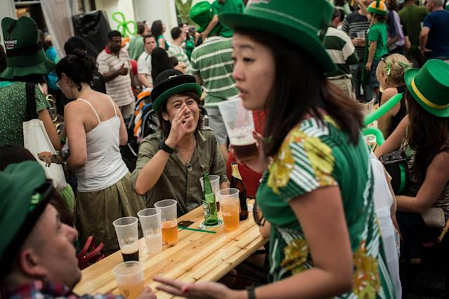 SINGAPORE - MARCH 17: People celebrate St Patricks Day during the Singapore St Patrick's Day street Festival at Boat Quay on March 17, 2013 in Singapore. Singapore's Irish community gathered at Boat Quay for a three-day-long St Patrick's Day Street Festival which featured street performances, buskers, and Irish food and drink. (Photo by Chris McGrath/Getty Images)