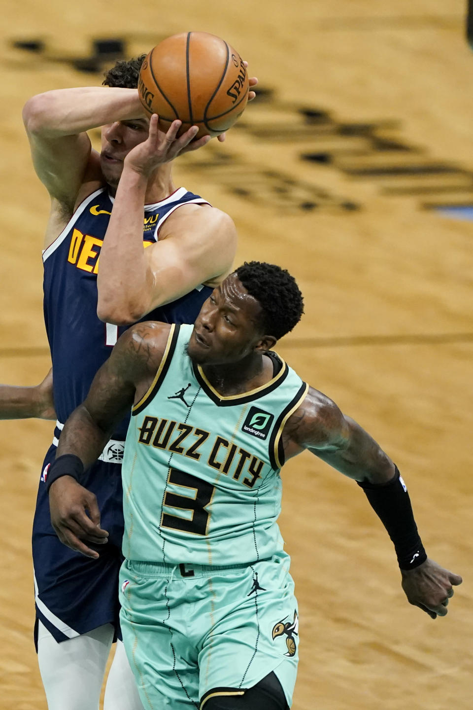 Denver Nuggets forward Michael Porter Jr. is fouled by Charlotte Hornets guard Terry Rozier during the first half of an NBA basketball game on Tuesday, May 11, 2021, in Charlotte, N.C. (AP Photo/Chris Carlson)