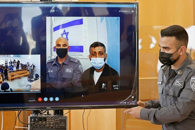 Palestinian militant Mohammad Ardah, one of the six escapees from an Israeli high-security prison, was recaptured on September 11. Here he is shown attending a court session via Zoom (AFP/JACK GUEZ)