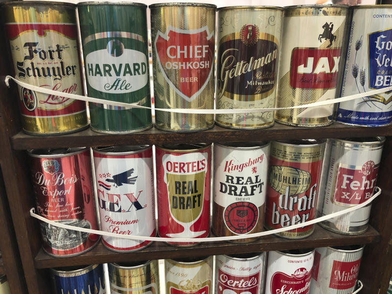 "Vintage mid-century beer cans are on display Thursday, Aug. 29, 2019, in Albuquerque, N.M., at the 49th annual gathering of members of the Brewery Collectibles Club of America. Collectors from around the world began Thursday buying, trading and selling containers of brews at the annual four-day event billed the ""CANvention."" (AP Photo/Russell Contreras)"